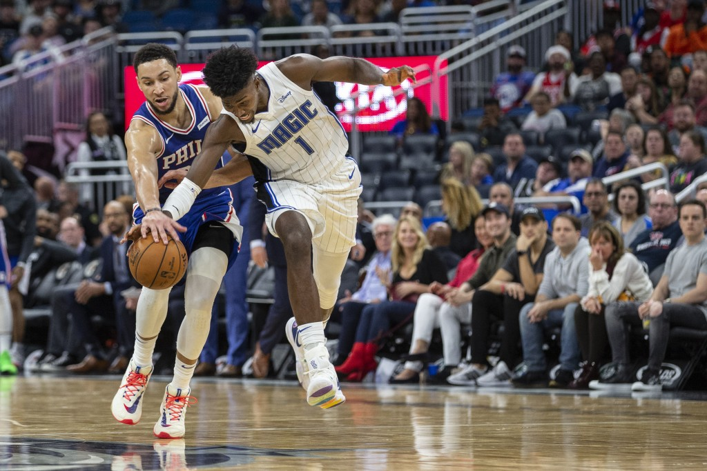 Philadelphia 76ers guard Ben Simmons (25) and Orlando Magic forward Jonathan Isaac (1) fight for the ball during the second half of an NBA basketball ...