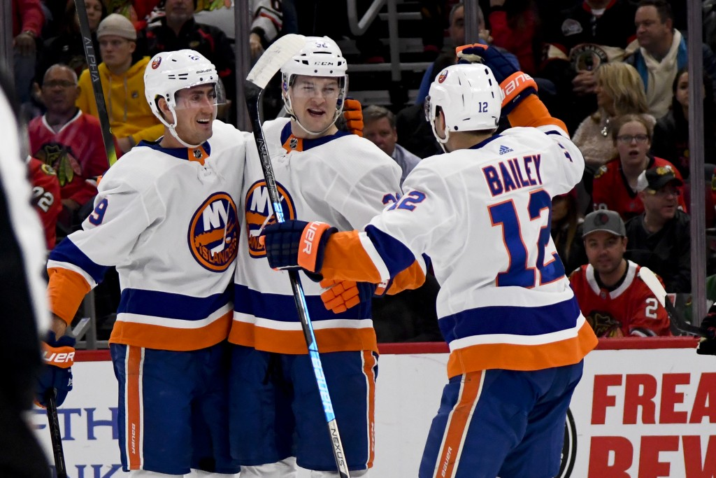 New York Islanders left wing Ross Johnston (32) celebrates with center Brock Nelson (29) and right wing Josh Bailey (12) after Johnston scored against...