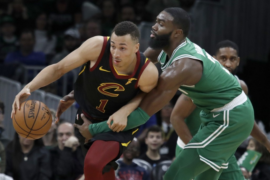 Cleveland Cavaliers Donte Eum, left, guard is fouled by Boston Celtics guard Jaylen Brown, right, in the first half of an NBA basketball game, Friday,...