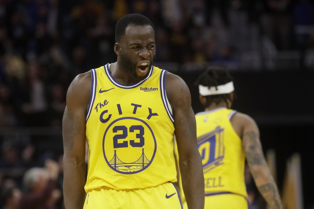 Golden State Warriors forward Draymond Green (23) yells toward the Phoenix Suns' bench after scoring during the second half of an NBA basketball game ...