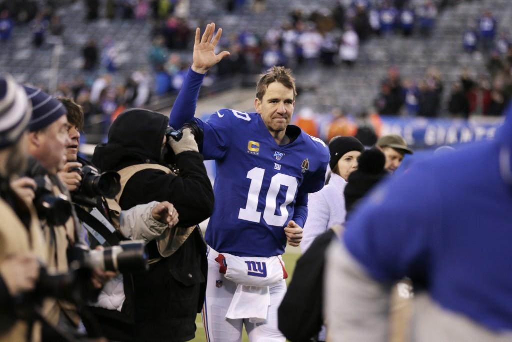 File-This Dec. 15, 2019, file photo shows New York Giants quarterback Eli Manning (10) leaving the field after defeating the Miami Dolphins in an NFL ...