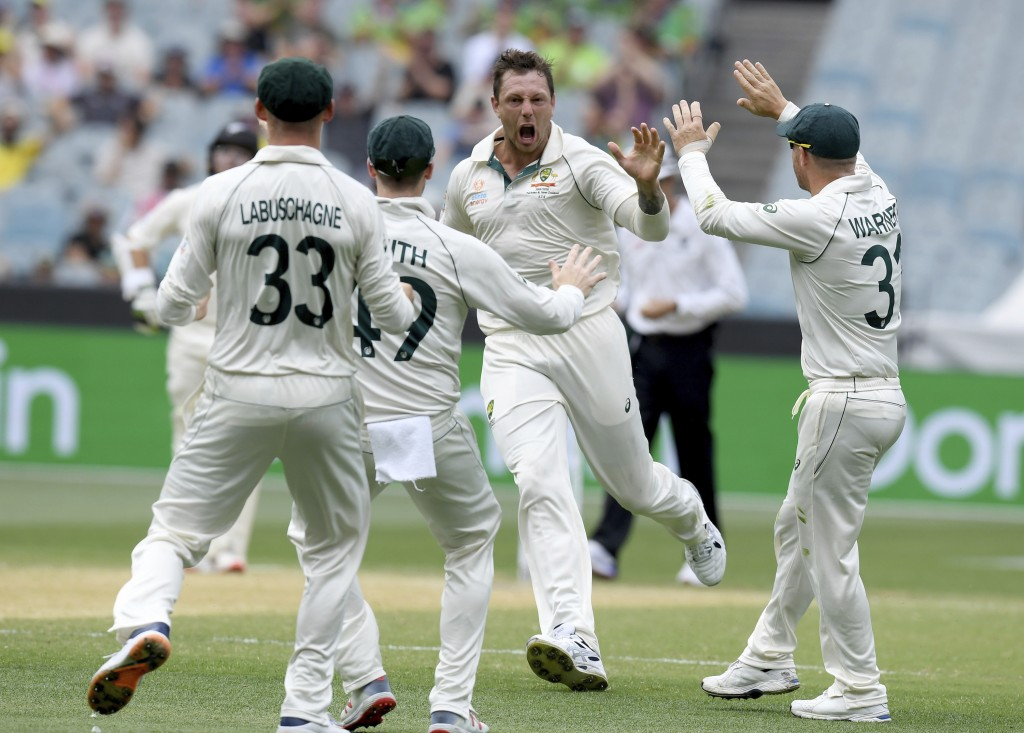 Australia's James Pattinson, center, celebrates with teammates after capturing the wicket of New Zealand's BJ Watling during a cricket test match in M...