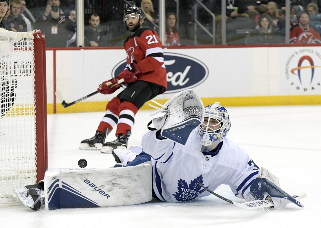 Toronto Maple Leafs goaltender Michael Hutchinson (30) cannot stop the puck as it goes into the net for a goal by New Jersey Devils left wing Jesper B...