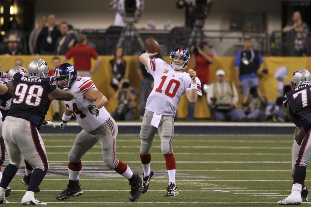 CORRECTS DATE TO FEB. 5, 2012- File- This Feb. 5, 2012, file photo shows New York Giants quarterback Eli Manning,  in action against the New England P...