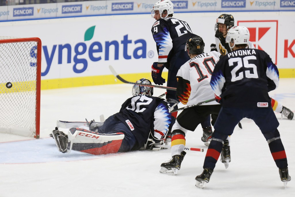From left, USA goalkeeper Dustin Wolf, Mattias Samuelsson, Germany's Justin Schuetz and Jacob Pivonka of the USA in action during the 2020 IIHF World ...