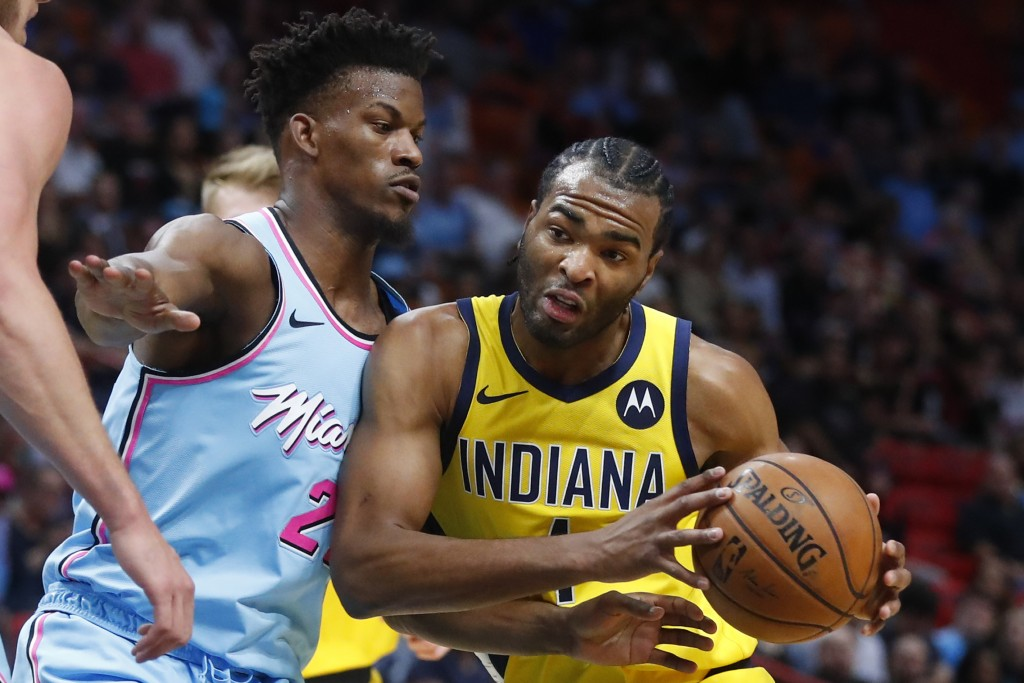 Indiana Pacers forward T.J. Warren (1) drives against Miami Heat forward Jimmy Butler (22) during the first half of an NBA basketball game Friday, Dec...