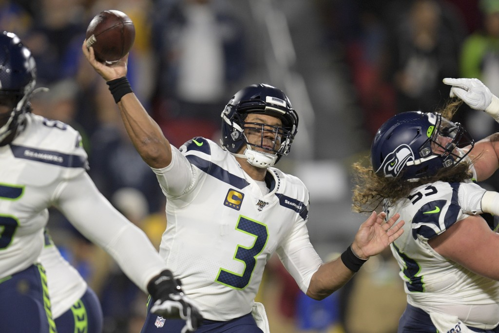 File-This Dec. 8, 2019, file photo shows Seattle Seahawks quarterback Russell Wilson passing during the first half of an NFL football game against the...