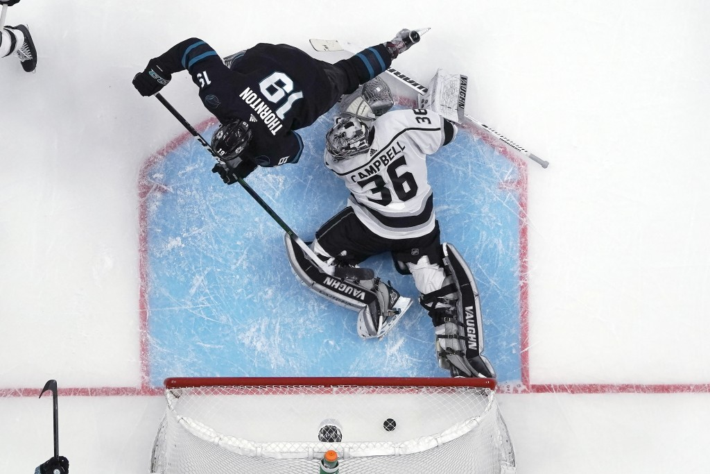 San Jose Sharks center Joe Thornton (19) scores a goal past Los Angeles Kings goaltender Jack Campbell (36) during the second period of an NHL hockey ...