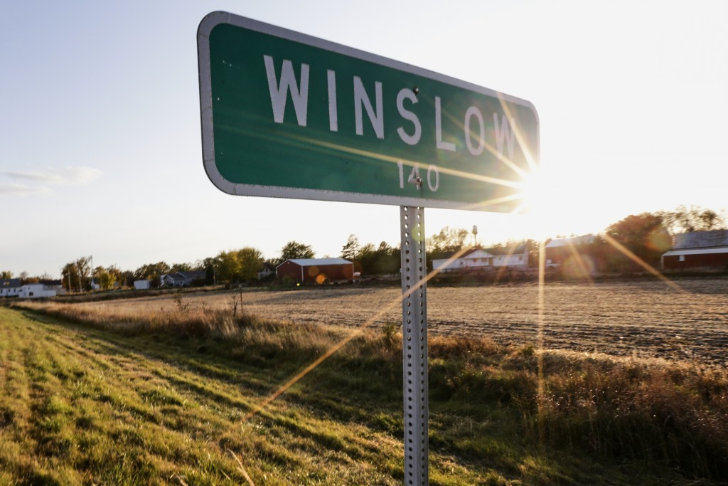 In this Oct. 24, 2019 photo, the sun sets over Winslow, Neb. It took only minutes for swift-moving floods from the Elkhorn River to ravage tiny Winslo...