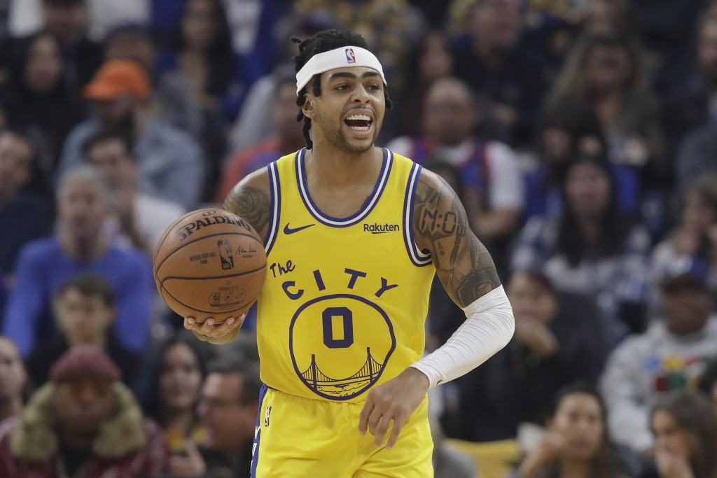 Golden State Warriors guard D'Angelo Russell dribbles upcourt against the Phoenix Suns during the first half of an NBA basketball game in San Francisc...