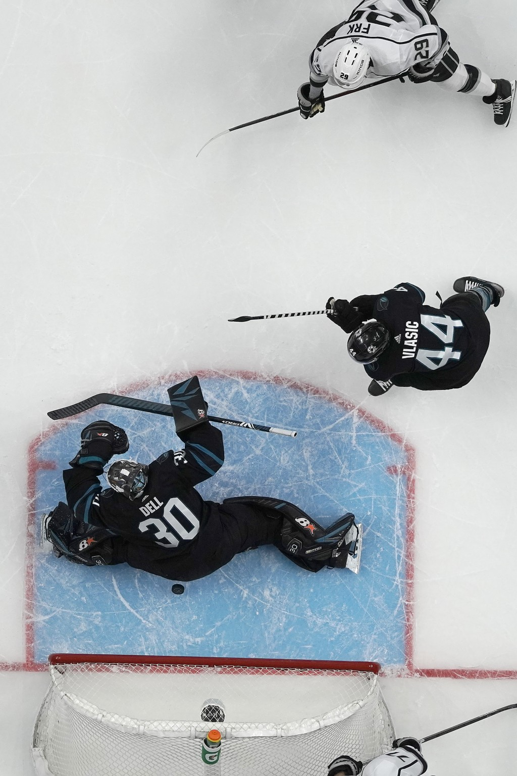 Los Angeles Kings' Martin Frk (29) scores a goal past San Jose Sharks goaltender Aaron Dell (30) during the third period of an NHL hockey game in San ...