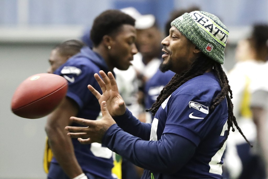 Seattle Seahawks running back Marshawn Lynch catches a football as he warms up for NFL football practice, Friday, Dec. 27, 2019, in Renton, Wash. The ...