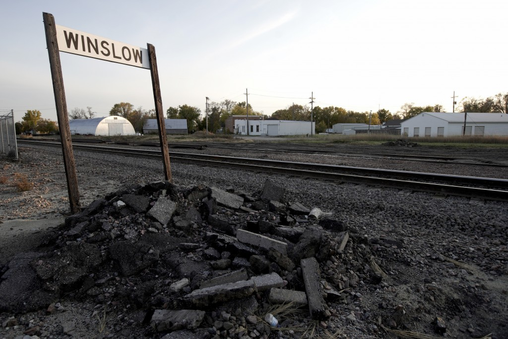 In this Oct. 24, 2019 photo, train tracks run through Winslow, Neb. It took only minutes for swift-moving floods from the Elkhorn River to ravage tiny...