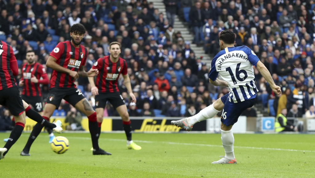 Brighton and Hove Albion's Alireza Jahanbakhsh scores against Bournemouth during the English Premier League soccer match at the AMEX Stadium, Brighton...