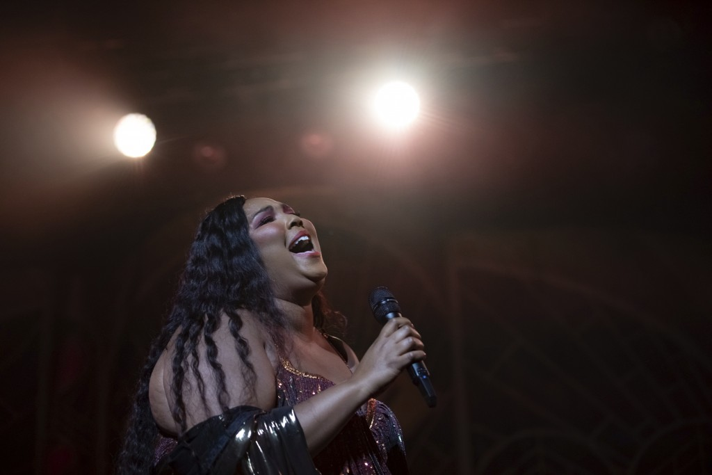 FILE - This Sept. 25, 2019 file photo shows Lizzo performing in Washington. Lizzo has been named Entertainer of the Year by The Associated Press. Vote...