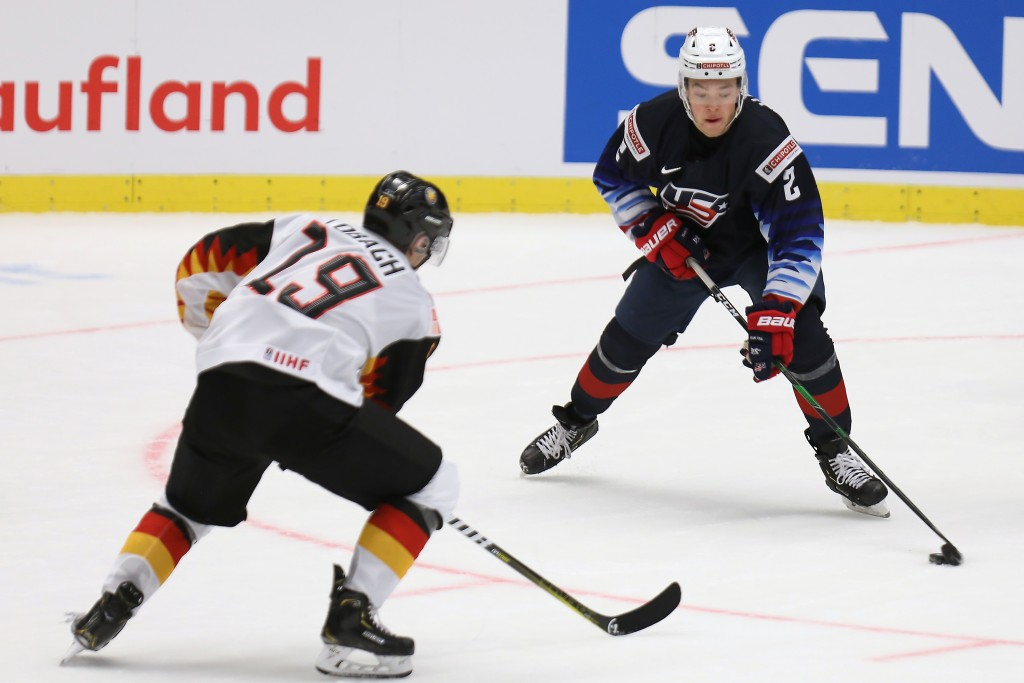 Germany's Dennis Lobach defends as United States' Jordan Harris carries the puck during the 2020 IIHF World Junior Ice Hockey Championships Group B ma...