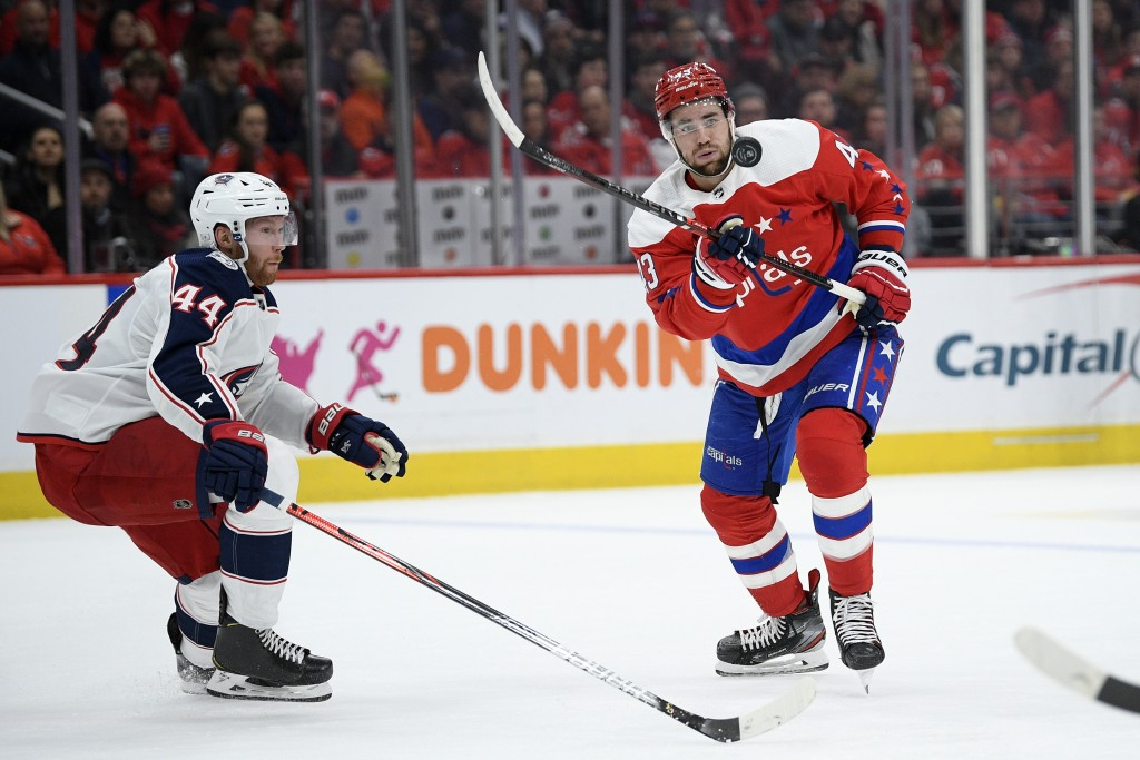 Washington Capitals right wing Tom Wilson (43) chases the puck next to Columbus Blue Jackets defenseman Vladislav Gavrikov (44) during the second peri...