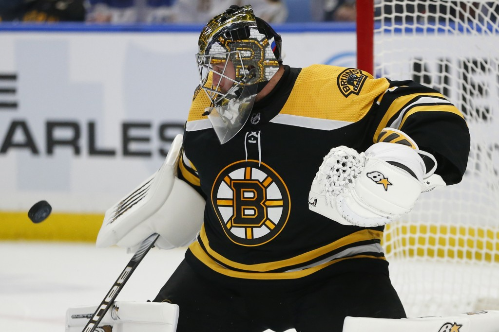 Boston Bruins goalie Jaroslav Halak (41) makes a save during the third period of an NHL hockey game against the Buffalo Sabres, Friday, Dec. 27, 2019,...