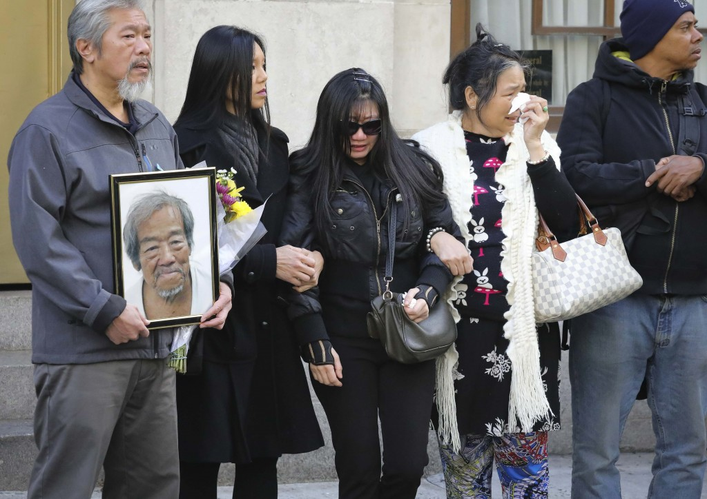 FILE - In this Oct. 18, 2019 file photo, mourners gather at a funeral service for Chuen Kok at the Ng Fook Funeral Home in New York. Kok, an 83-year-o...
