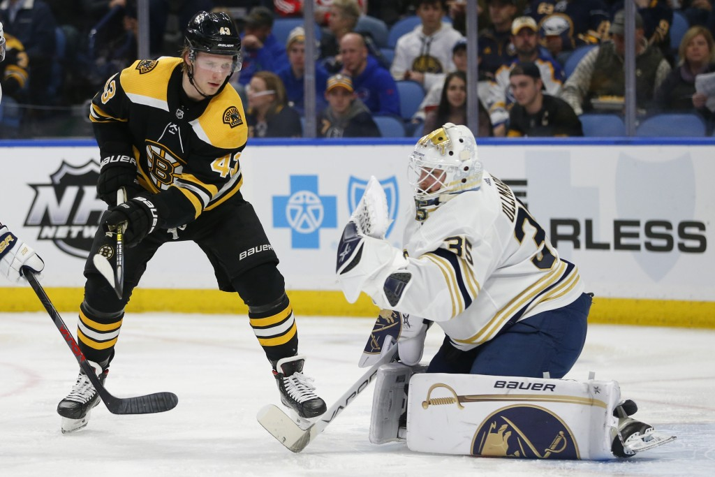 Buffalo Sabres goalie Linus Ullmark (35) stops Boston Bruins forward Danton Heinen (43) during the second period of an NHL hockey game Friday, Dec. 27...
