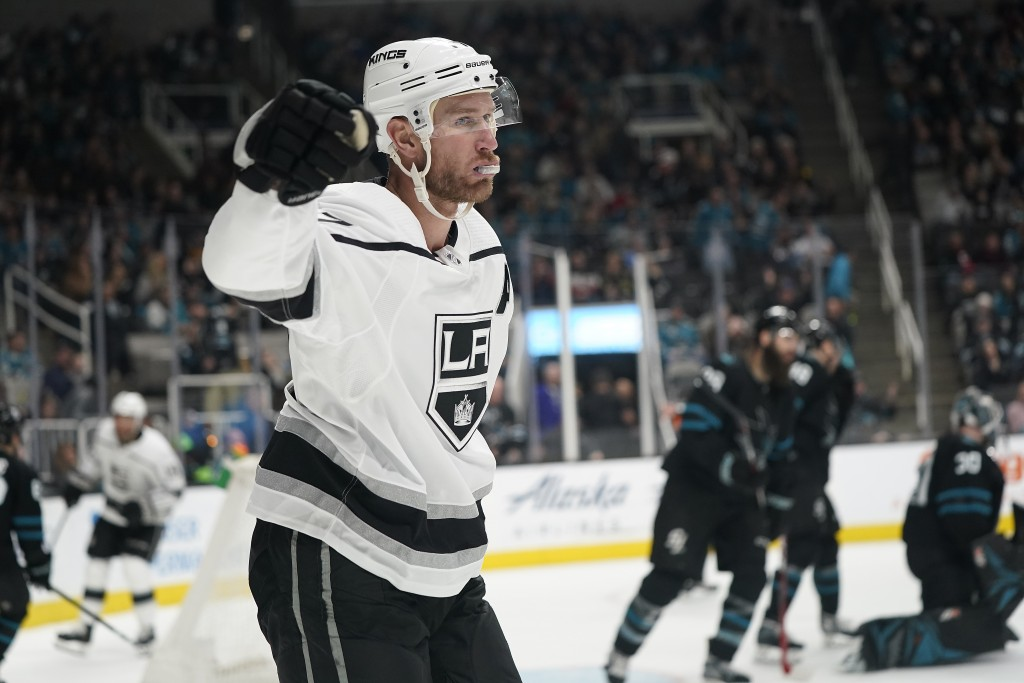 Los Angeles Kings center Jeff Carter (77) reacts after scoring during overtime against the San Jose Sharks in an NHL hockey game in San Jose, Calif., ...