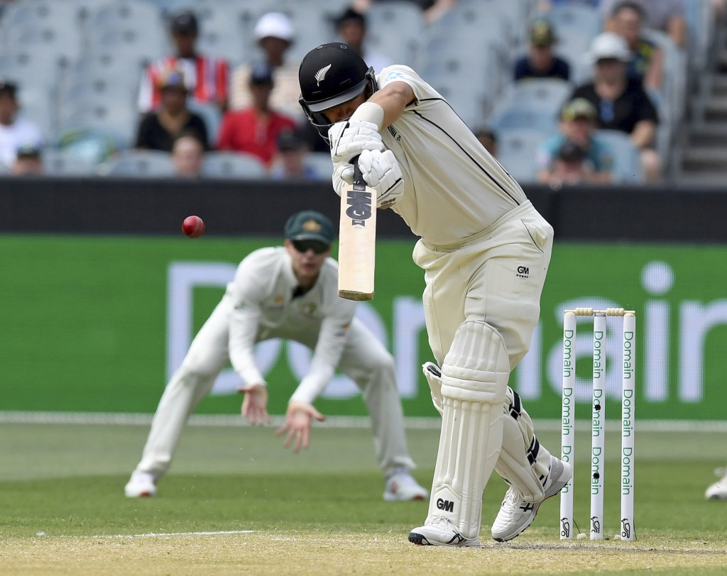 New Zealand's Ross Taylor edges the ball to slips to be dismissed by Australia during their cricket test match in Melbourne, Australia, Saturday, Dec....
