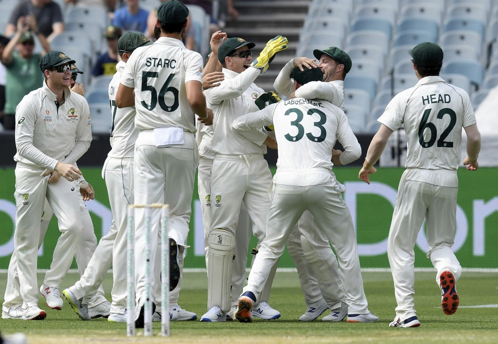Australian players celebrate the wicket of New Zealand's Ross Taylor during their cricket test match in Melbourne, Australia, Saturday, Dec. 28, 2019....