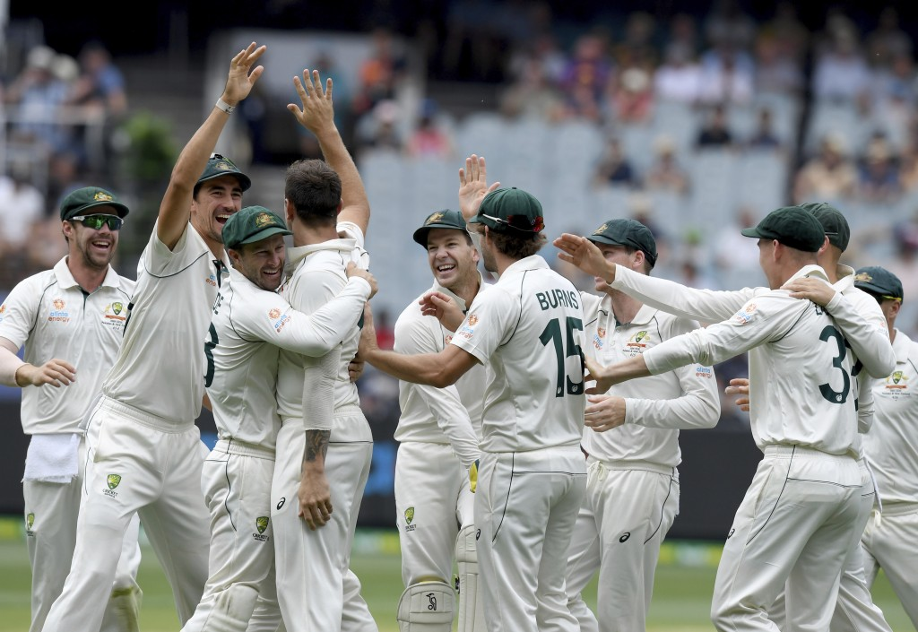 Australia players celebrate with James Pattinson after capturing the wicket of New Zealand's BJ Watling during a cricket test match in Melbourne, Aust...