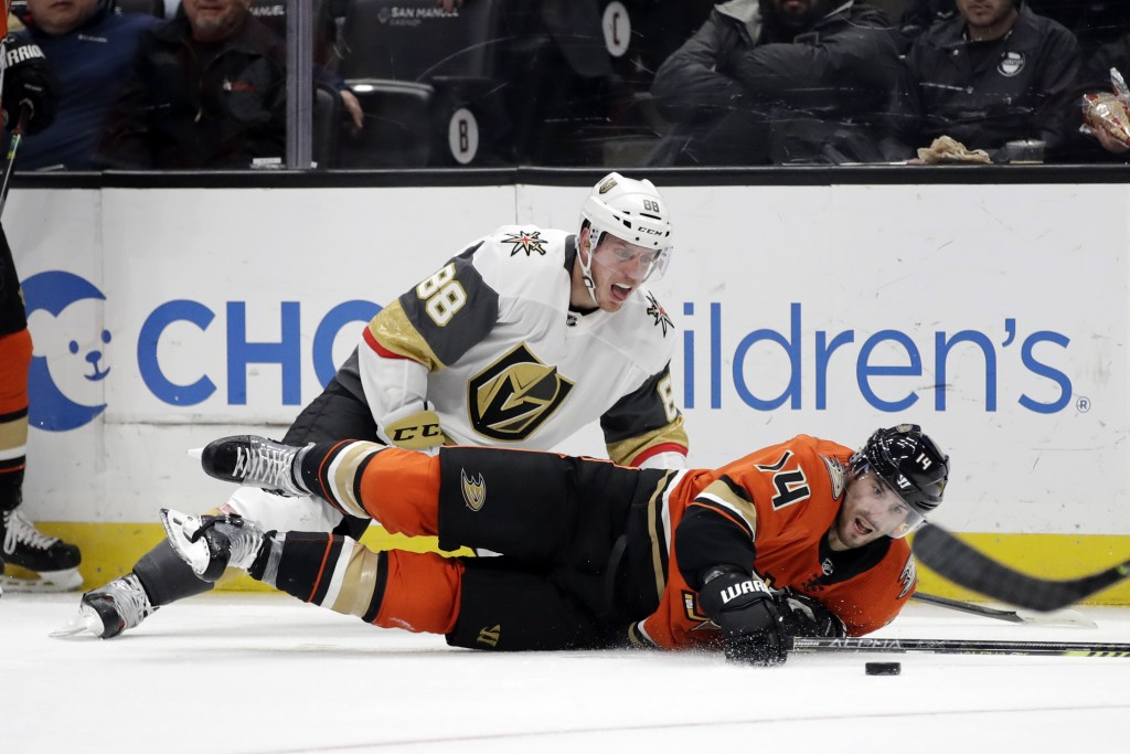 Vegas Golden Knights' Nate Schmidt (88) collides with Anaheim Ducks' Adam Henrique (14) during the second period of an NHL hockey game Friday, Dec. 27...