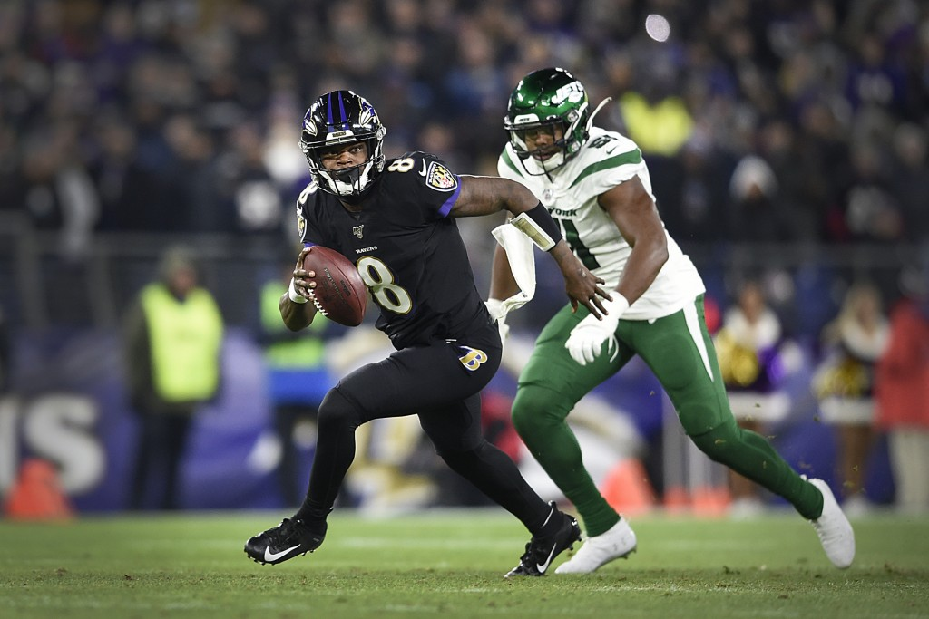 File-This Dec. 12, 2019, file photo shows Baltimore Ravens quarterback Lamar Jackson running during the first half of an NFL football game in Baltimor...