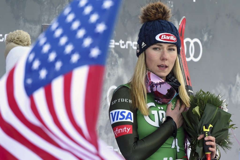 United States' Mikaela Shiffrin, winner of an alpine ski, women's World Cup giant slalom, listens to the national anthem, in Lienz, Austria, Saturday,...