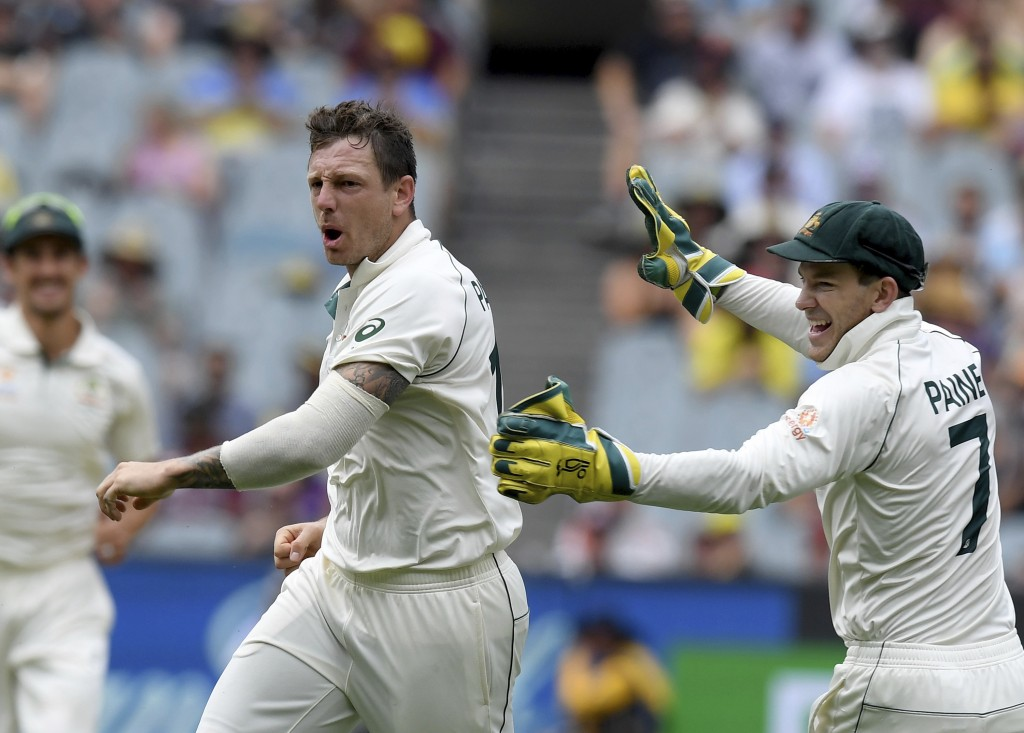 Australia's James Pattinson, left celebrates with team mate Tim Paine, right, after capturing the wicket of New Zealand's BJ Watling during a cricket ...