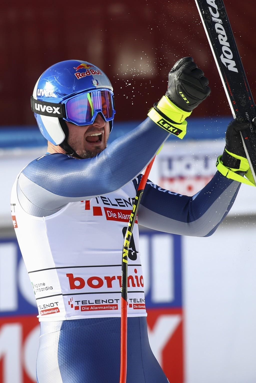 Italy's Dominik Paris celebrates at the finish area of an alpine ski, men's World Cup downhill, in Bormio, Italy, Saturday, Dec. 28, 2019. (AP Photo/A...