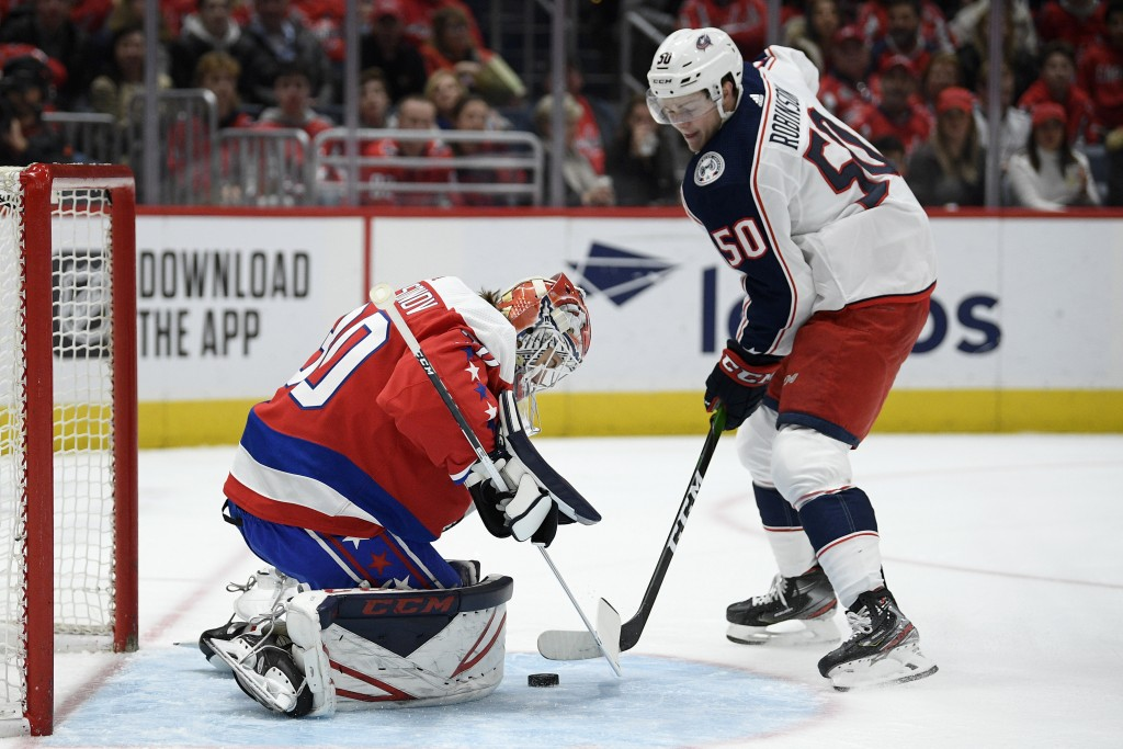 Washington Capitals goaltender Ilya Samsonov (30), of Russia, defends the net next to Columbus Blue Jackets left wing Eric Robinson (50) during the fi...