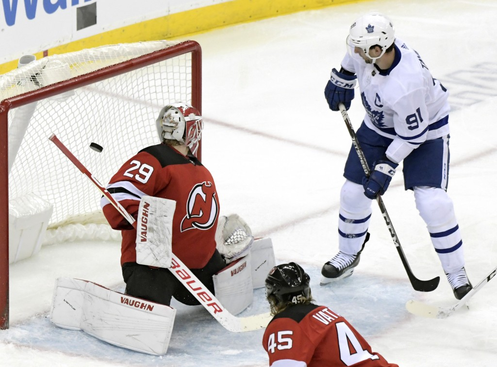 Toronto Maple Leafs center John Tavares (91) scores a goal past New Jersey Devils goaltender Mackenzie Blackwood (29) during the third period of an NH...