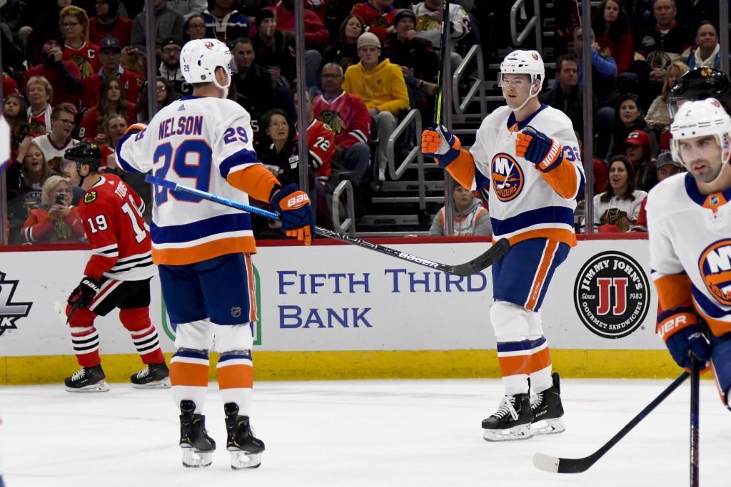 New York Islanders left wing Ross Johnston (32) celebrates with center Brock Nelson (29) after Johnston scored against the Chicago Blackhawks during t...