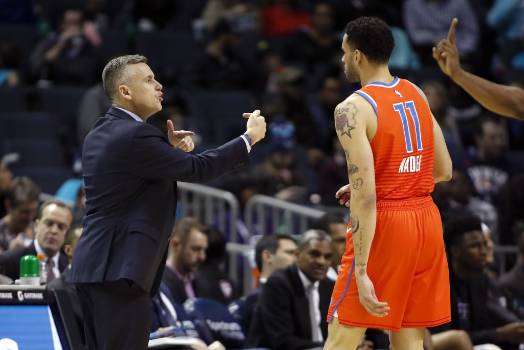 Oklahoma City Thunder coach Billy Donovan talks to Abdel Nader (11) and teammates during the first half of an NBA basketball game against the Charlott...