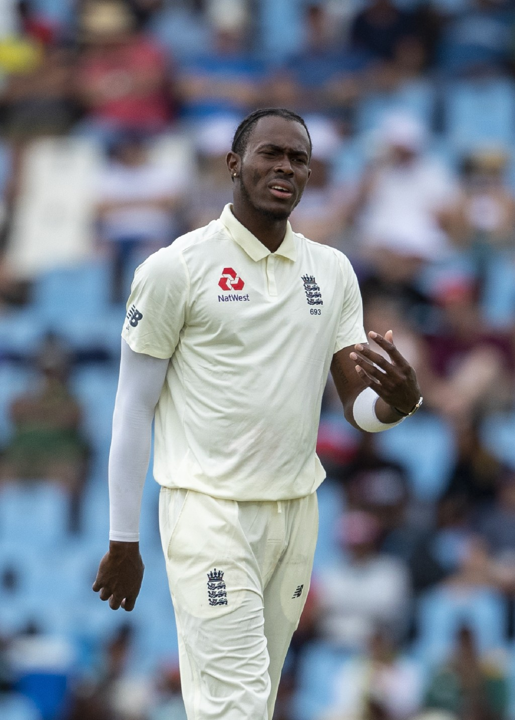 England's bowler Jofra Archer reacts after his delivery against South Africa's batsman Kagiso Rabada on day three of the first cricket test match betw...