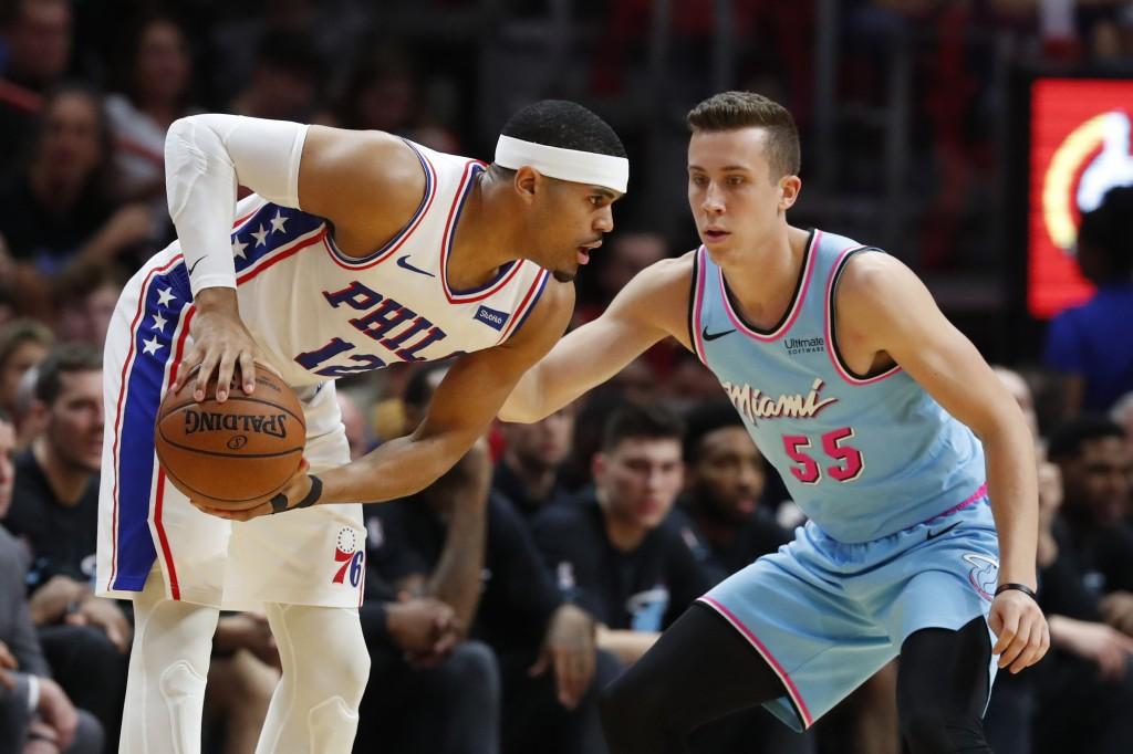 Philadelphia 76ers forward Tobias Harris (12) looks for an open teammate past Miami Heat forward Duncan Robinson (55) during the first half of an NBA ...