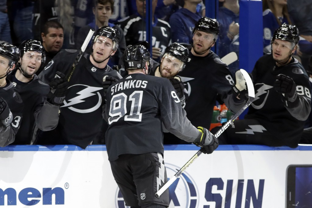 Tampa Bay Lightning center Steven Stamkos (91) celebrates with the bench after his goal against the Montreal Canadiens during the second period of an ...