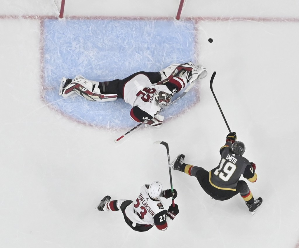 Vegas Golden Knights right wing Reilly Smith (19) shoots against Arizona Coyotes goaltender Antti Raanta (32) during the first period of an NHL hockey...