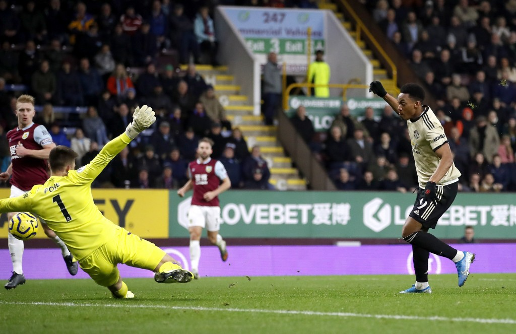 Manchester United's Anthony Martial, right, scores a goal against Burnley during the English Premier League soccer match at Turf Moor, Burnley, Englan...