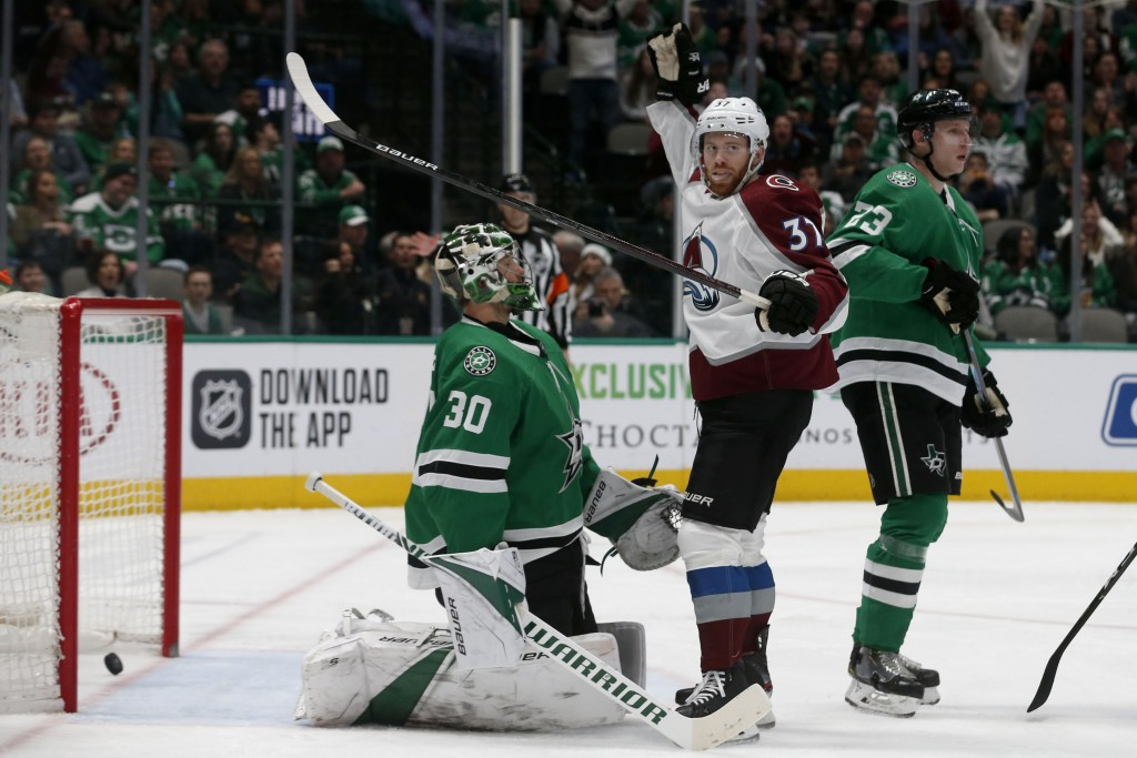 Colorado Avalanche left wing J.T. Compher (37) celebrates a goal by teammate Ian Cole, not pictured, in front of Dallas Stars goaltender Ben Bishop (3...