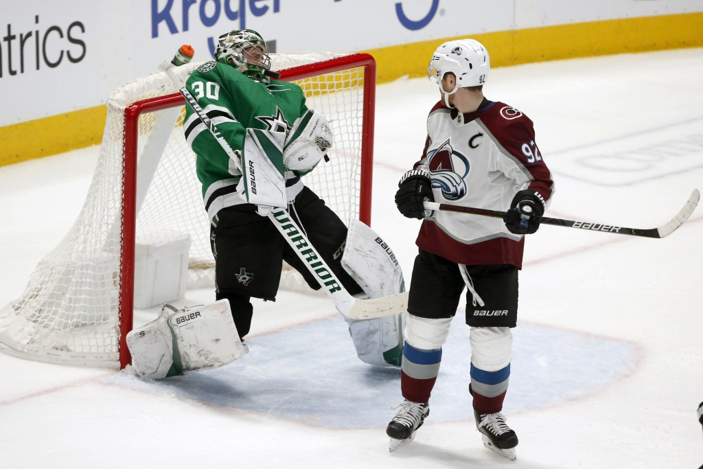 Dallas Stars goaltender Ben Bishop (30) makes a save off his head as Colorado Avalanche left wing Gabriel Landeskog (92) watches during the second per...