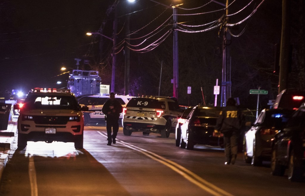 Authorities gather on a street in Monsey, N.Y., Sunday, Dec. 29, 2019, following a stabbing late Saturday during a Hanukkah celebration. A man attacke...