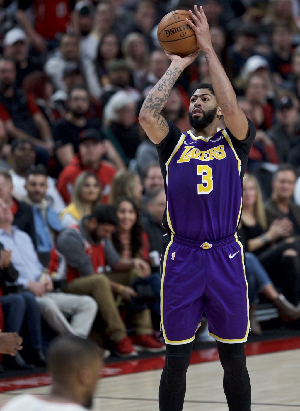 Los Angeles Lakers forward Anthony Davis shoots against the Portland Trail Blazers during the first half of an NBA basketball game in Portland, Ore., ...