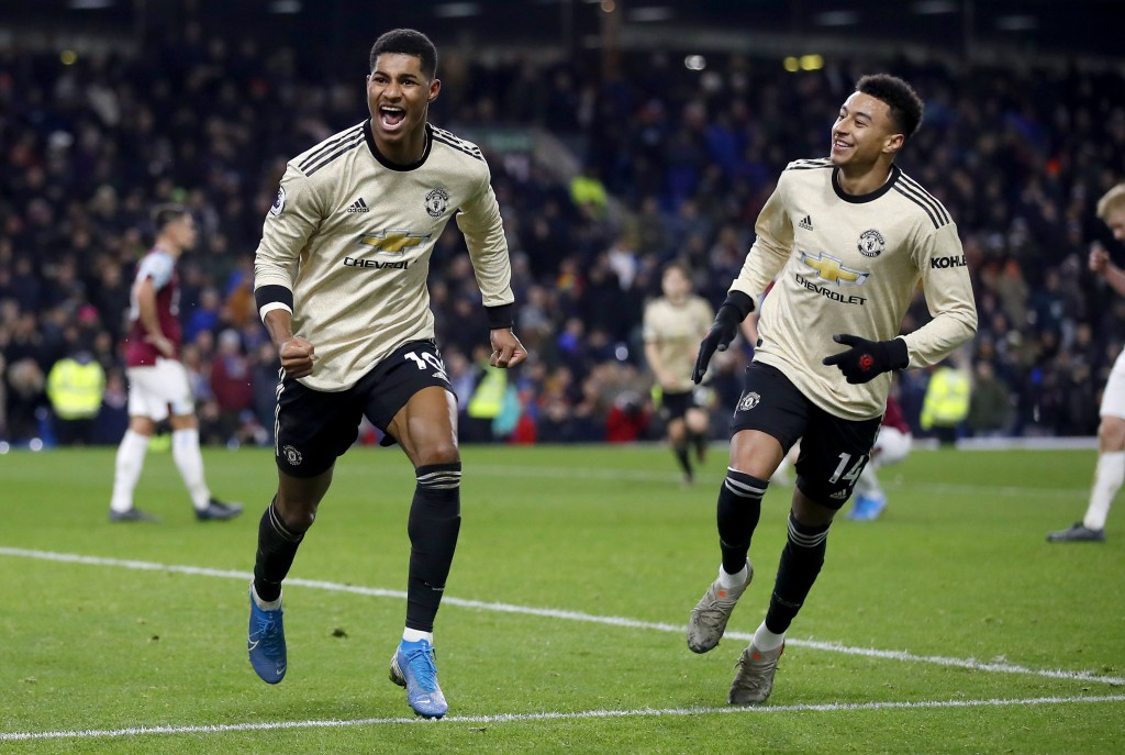 Manchester United's Marcus Rashford, left, celebrates scoring his second goal of the game with team mate Jesse Lingard during the English Premier Leag...
