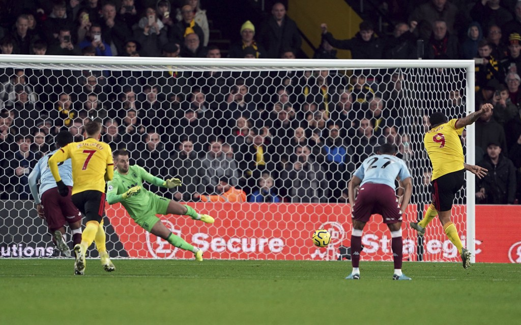 Watford's Troy Deeney scores against Aston Villa during the English Premier League soccer match at Vicarage Road, Watford, England, Saturday Dec. 28, ...