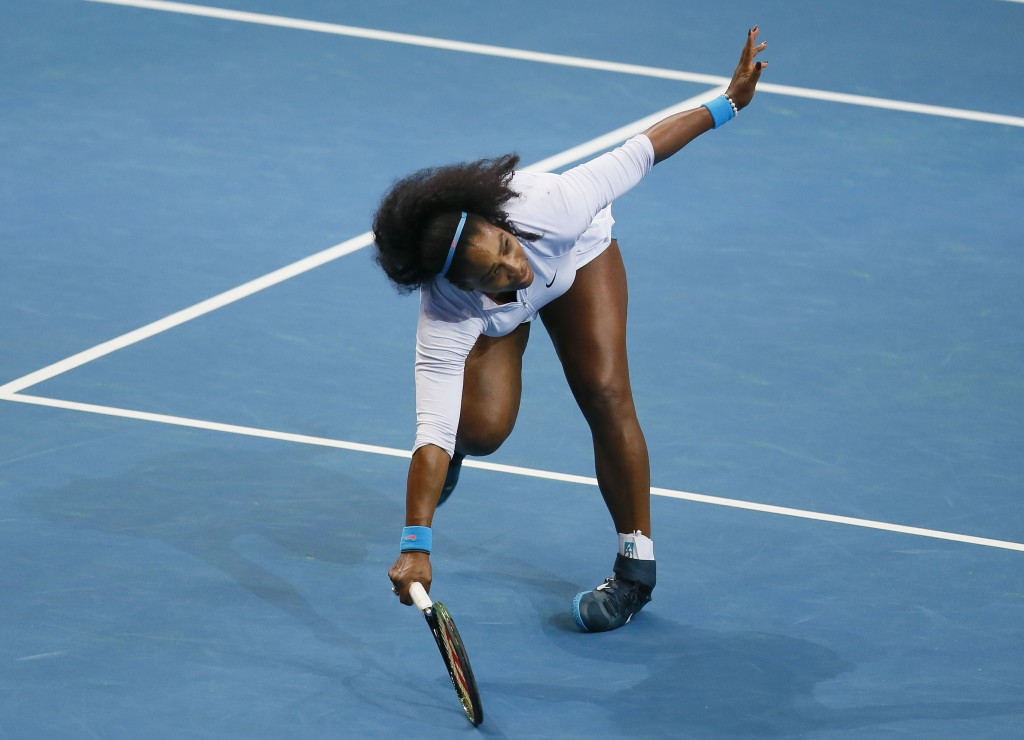 File-This Dec. 7, 2015, file photo shows USA's Serena Williams tripping as she returns a shot to Croatia's Mirjana Lucic-Baroni of Japan Warriors in t...