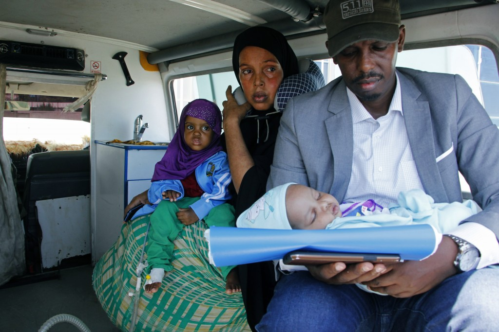 A mother and father carry their wounded child to be airlifted to the Turkish capital for treatment after they were injured in Saturday's car bomb blas...